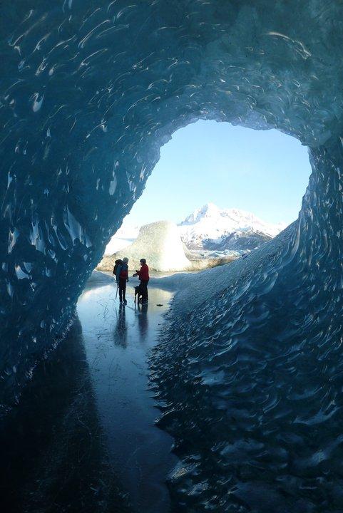 Skating into a glacier cavern at Sheridan Lake, Cordova AK