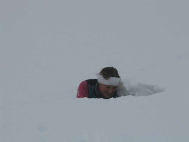 Lauren Padawer digs a pit to check snow conditions near Cordova AK