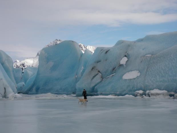 Bert and Monte skating by the blue ice of Sheridan Glacier, Cordova AK