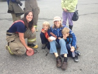 me with a couple future firefighters at the CVFD Car Smash fundraiser