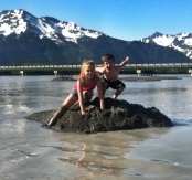 Austin and Shaunessi, cooling off in 9-mile sand pit and glacier water (91 degrees)